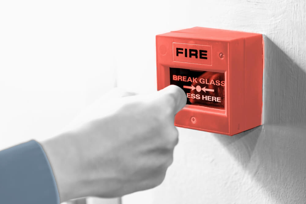 Operator performing a Fire Alarm Test