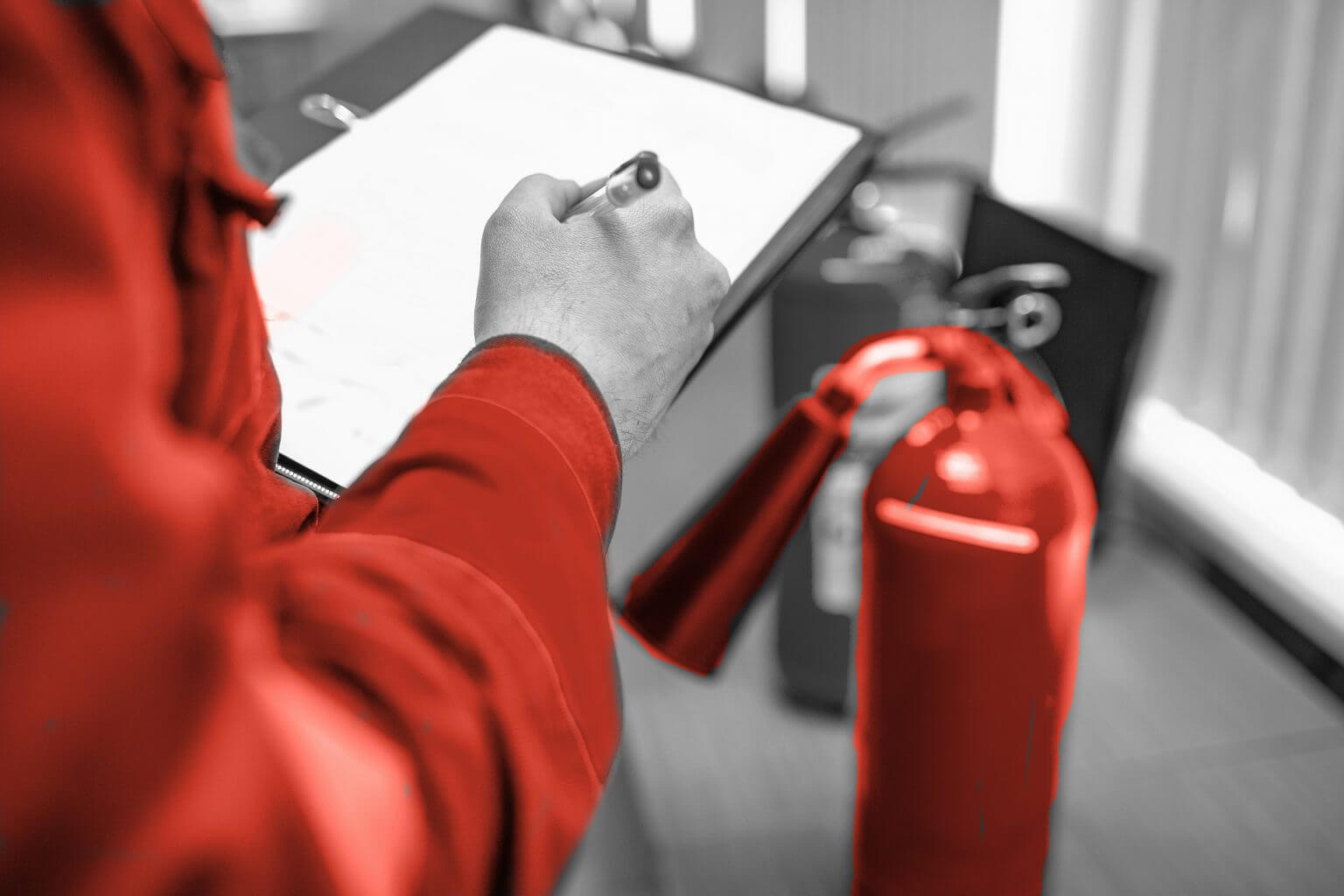 Operator inspecting a fire extinguisher